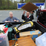 Nancy Krajewski, left, and her husband Steve begin to unload their pick-up truck full of stuff as they arrive at Clear Your Clutter Day Saturday at Harford Community College.